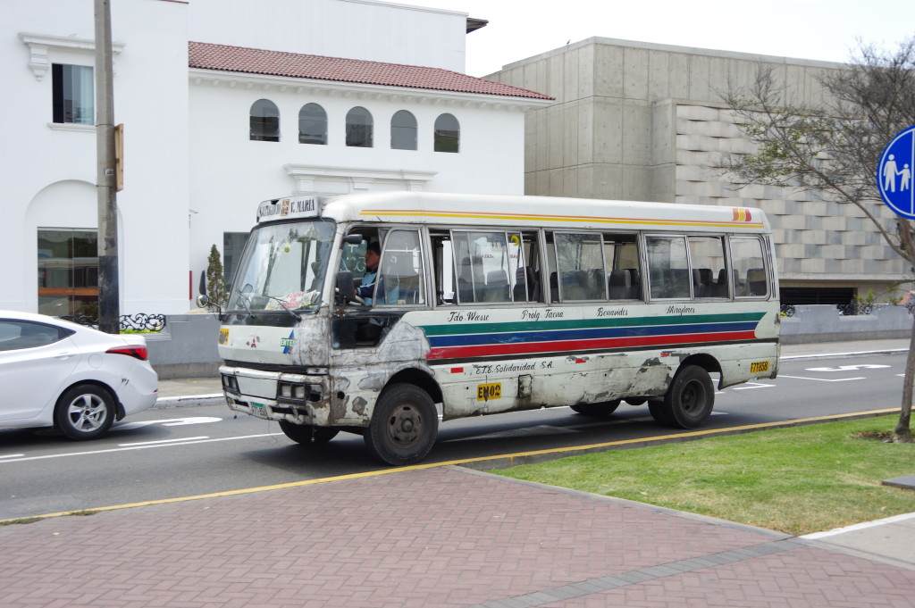 Crappy-looking local buses are common even in rich neighborhoods