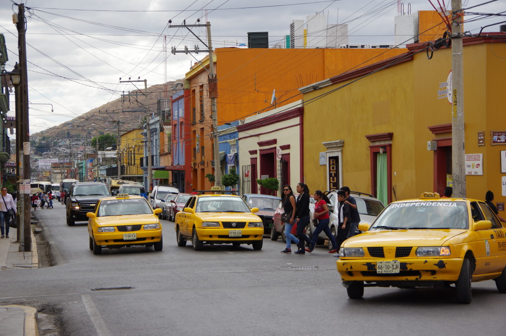 Busy city street with yellow taxis