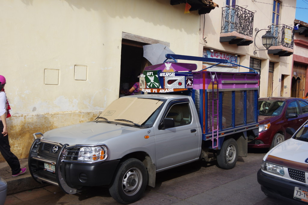 Pickup truck ornated with dubious religious symbols (most trucks in the area have them)
