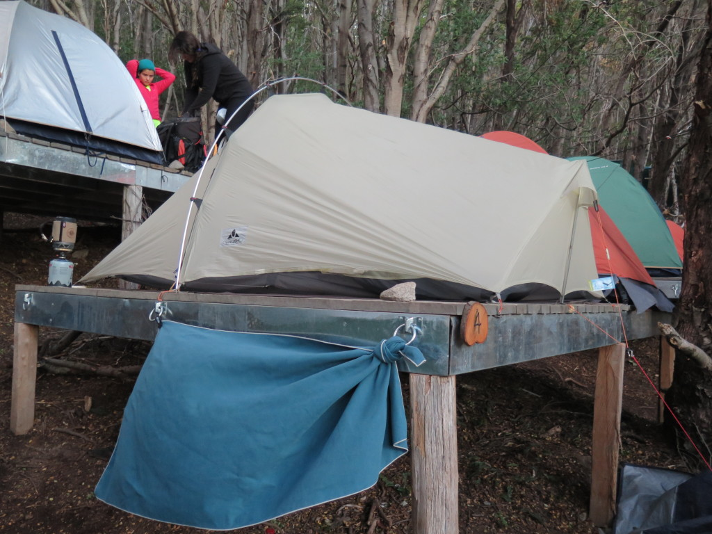 Tent pitched on a wooden platform using hammer and nails