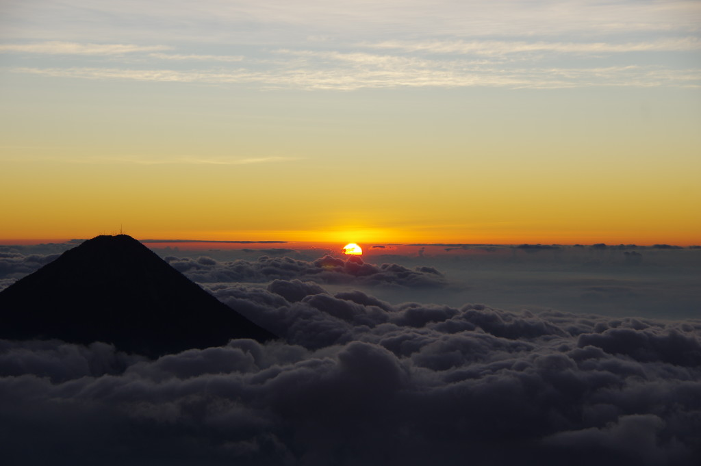 Sunrise on Acatenango, with Fuego rising out of the clouds